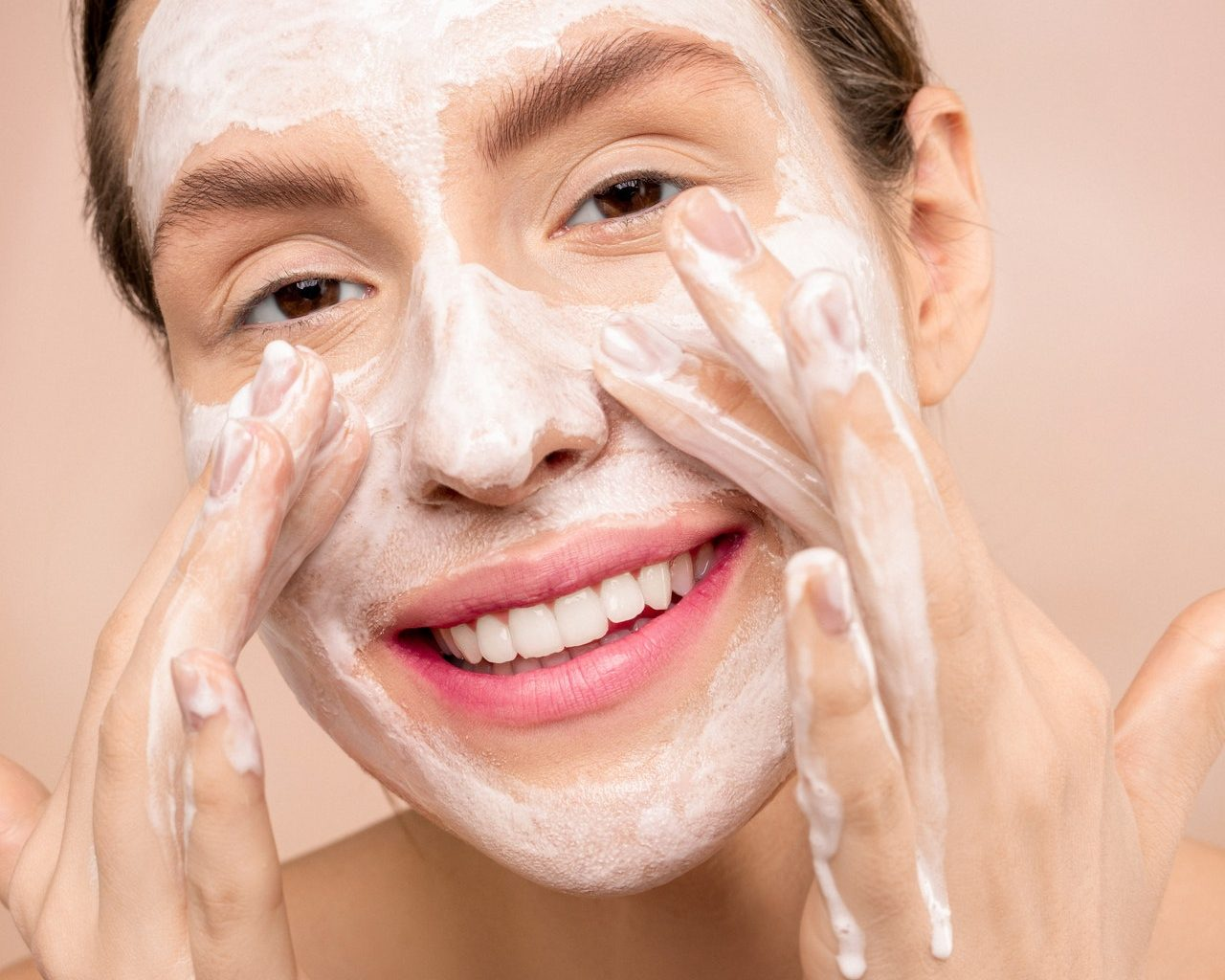 woman washing her face with soap 3762455